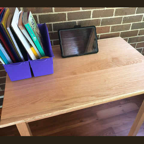 Handmade wood desk with school work and tablet on display