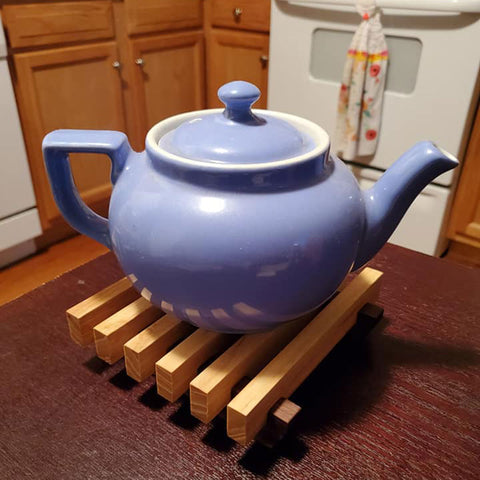 Wood Trivet with blue teapot on top