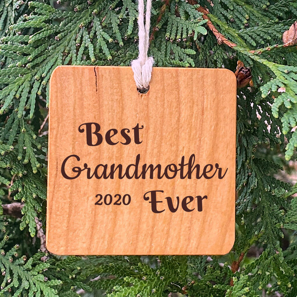 Best Grandfather Ever on pine tree background.