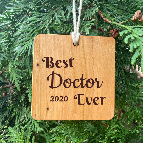 Best Doctor Ever Ornament on pine tree background.