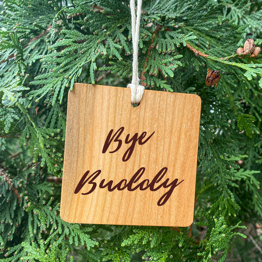 Bye Buddy the Elf Ornament on green pine tree background
