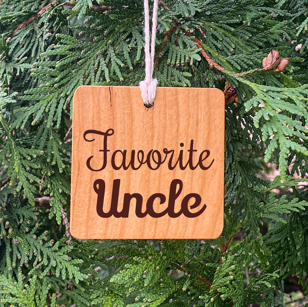 Wood ornament laser engraved text Favorite Uncle.
