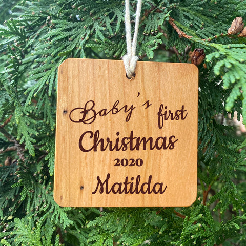 Baby's First Christmas Ornament on Pine Tree Background