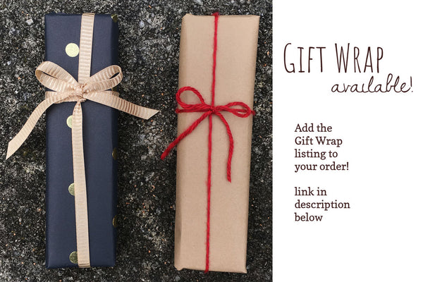 Gift Wrapped boxes with text Wrapping Available