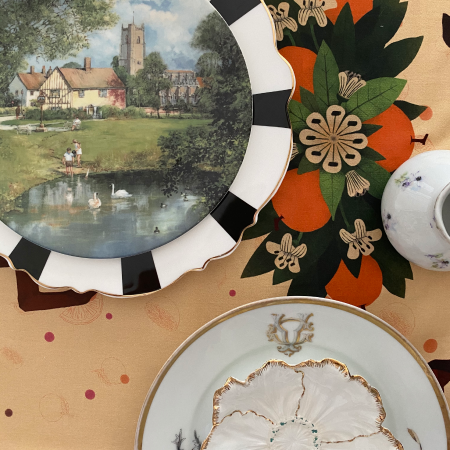 Closeup shot of Prado y Barrio SPRING Table linen with antique tableware.