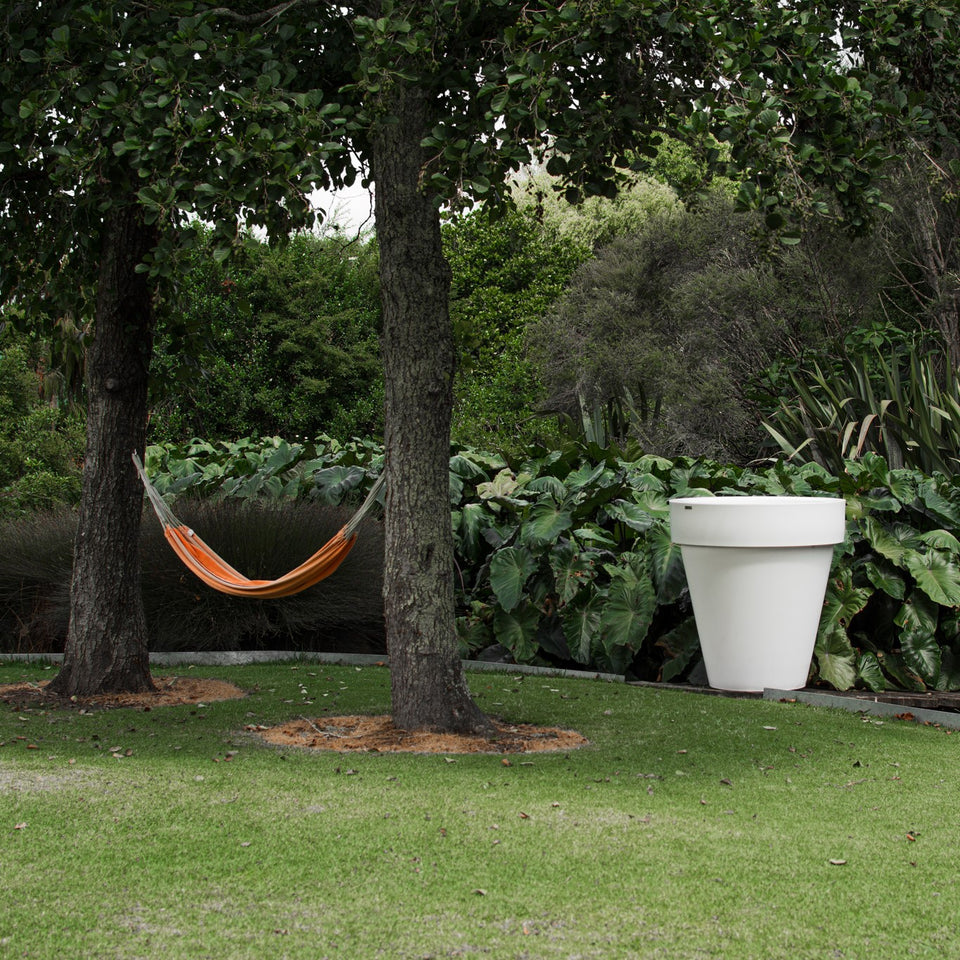 Large White planter in a garden. NZ Made planter by Modscene.