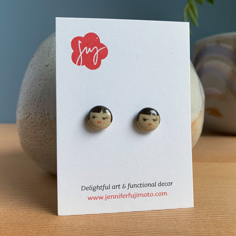 small round face earrings on a backing card