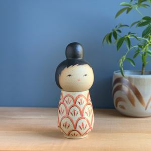 Red Flourish Kokeshi-Inspired Ceramic Doll