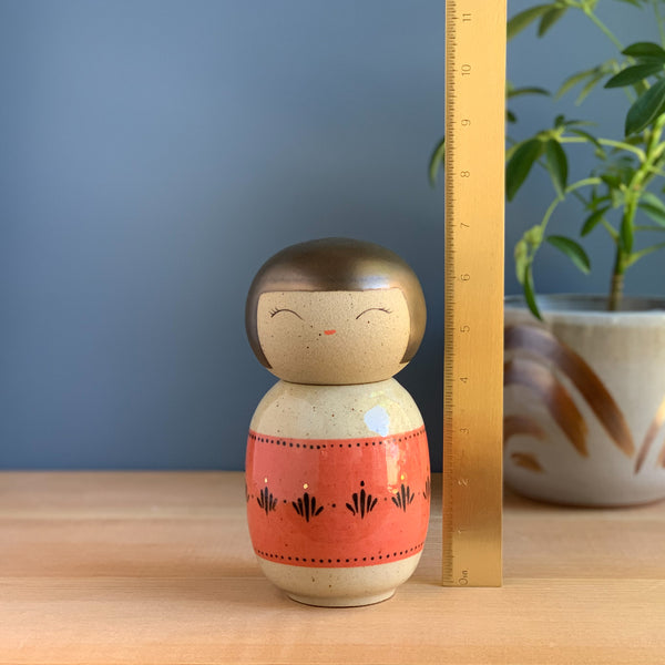 Wide Red Ribbon Kokeshi-Inspired Ceramic Doll
