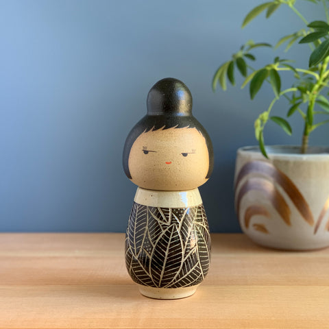 Carved Leaves in Black Kokeshi-Inspired Ceramic Doll