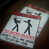 """WARNING don't tell me how to do my job"" sticker."