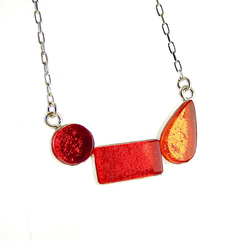 modern art inspired 3 element necklace, red, orange, fused glass, glass jewelry, glass and silver jewelry, handmade, handcrafted, American Craft, hand fabricated jewelry, hand fabricated jewellery, Athen, Georgia, colorful jewelry, sparkle, bullseye glass, dichroic glass, art jewelry