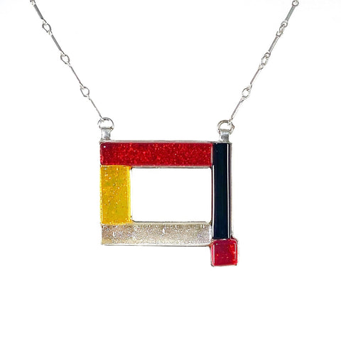 open rectangle necklace, mid century modern inspired, red, yellow, black and white, fused glass, glass jewelry, glass and silver jewelry, handmade, handcrafted, American Craft, hand fabricated jewelry, hand fabricated jewellery,  Athen, Georgia, colorful jewelry, sparkle, bullseye glass, dichroic glass, art jewelry