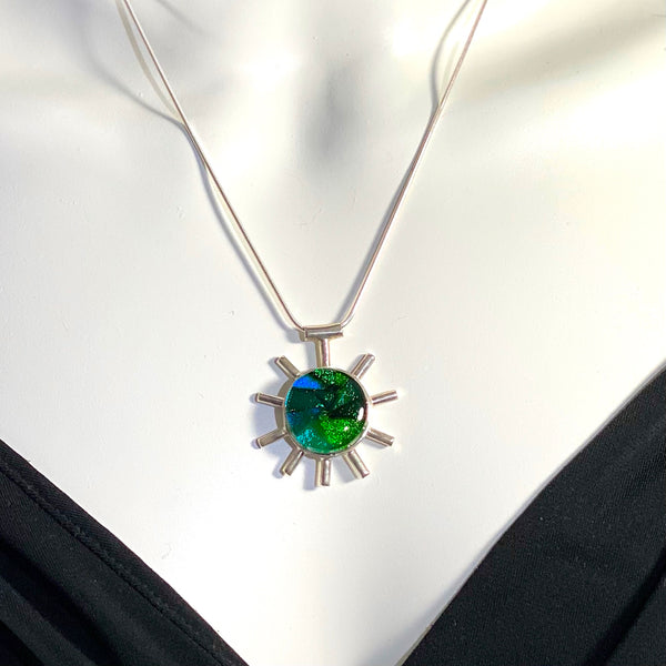 green melange, blue, green, abstract corona pendant necklace, fused glass, glass jewelry, glass and silver jewelry, handmade, handcrafted, American Craft, hand fabricated jewelry, hand fabricated jewellery, Athen, Georgia, colorful jewelry, sparkle, bullseye glass, dichroic glass, art jewelry