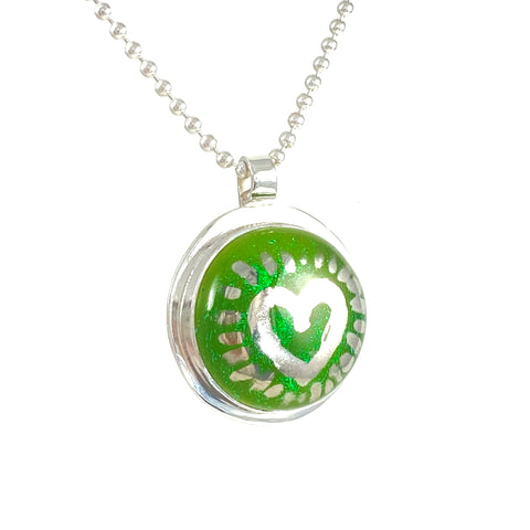 Silver luster painted heart over green necklace, fused glass, glass jewelry, glass and silver jewelry, handmade, handcrafted, American Craft, hand fabricated jewelry, hand fabricated jewellery,  Athen, Georgia, colorful jewelry, sparkle, bullseye glass, dichroic glass, art jewelry