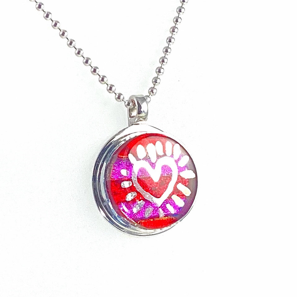 Silver luster painted striped circle necklace in pink and purple, fused glass, glass jewelry, glass and silver jewelry, handmade, handcrafted, American Craft, hand fabricated jewelry, hand fabricated jewellery,  Athen, Georgia, colorful jewelry, sparkle, bullseye glass, dichroic glass, art jewelry