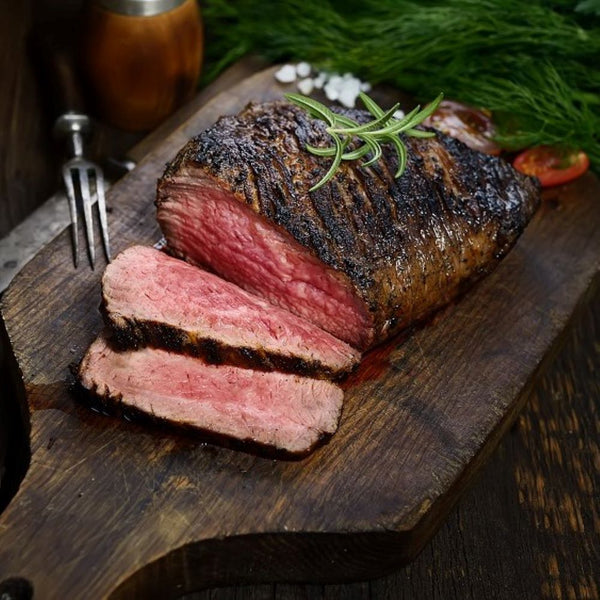 Smoked garlic stuffed striploin with horseradish jus. Serves 20 guests