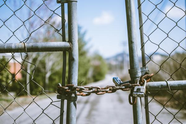 Padlocked chain-link gate. Photo by Travis Saylor from Pexels