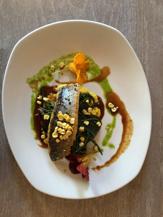 Duo of sea bass on a plate, seen from above