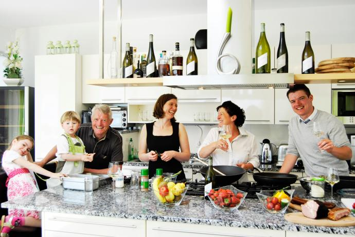 The Pfaffl family in the kitchen enjoying some of their own Austrian wines