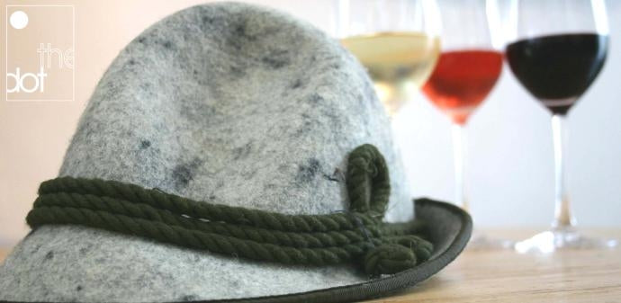 Austrian felt hat with glasses of wine in the background