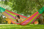 outdoor cotton hammock in pink and yellow