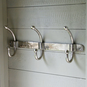 Row of three classic aluminium wall mounted coat hooks