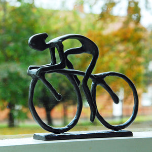 Cast racing cyclist statue