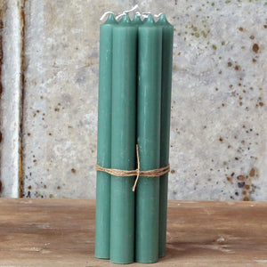 Tied bundle seven handmade Danish antique green dinner candles