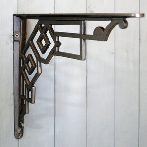 Brighton antique art deco style iron wall shelf bracket.