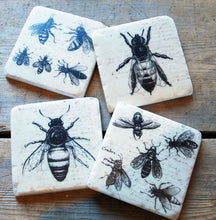 Boxed set of four assorted vintage bee design drinks coasters