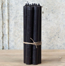 Tied bundle seven handmade Danish jet black dinner candles