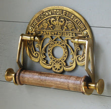 Antique brass crown design wall mounted toilet roll holder.