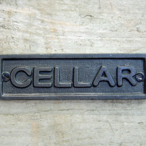 Traditional cast metal cellar door sign