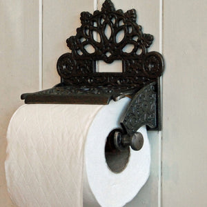 County Victorian style cast metal wall mounted toilet roll holder.
