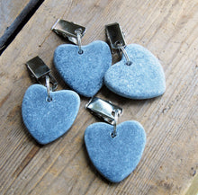 Set of four dark grey heart shaped stone table cloth weights