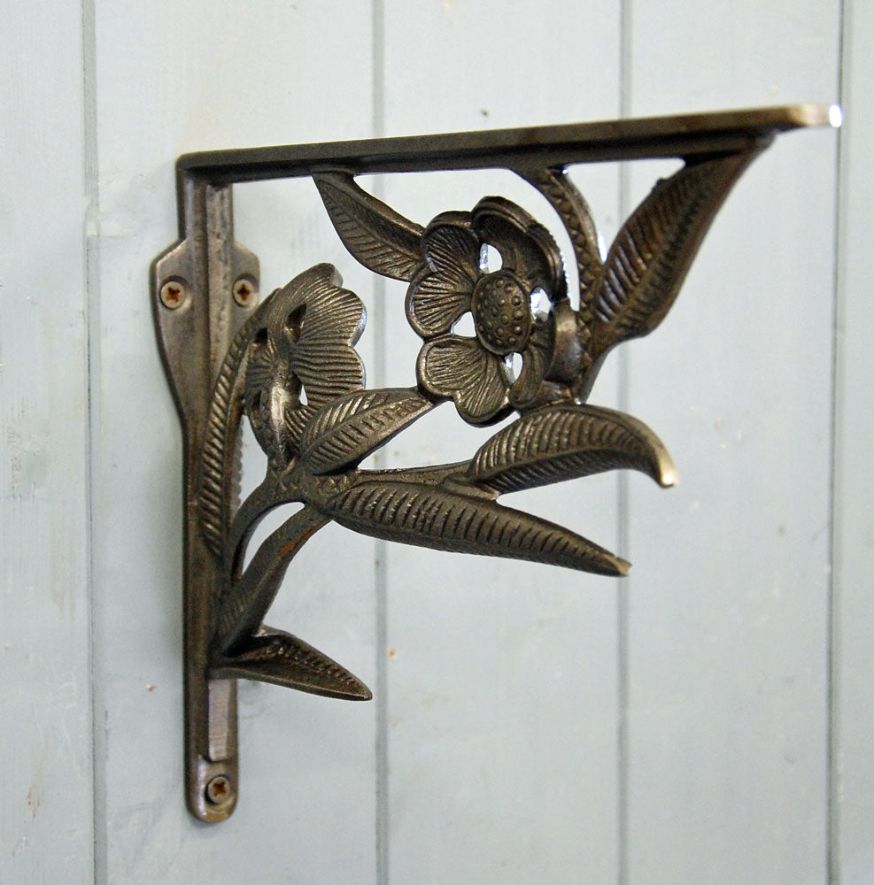 Deco flower antique style iron wall shelf bracket.