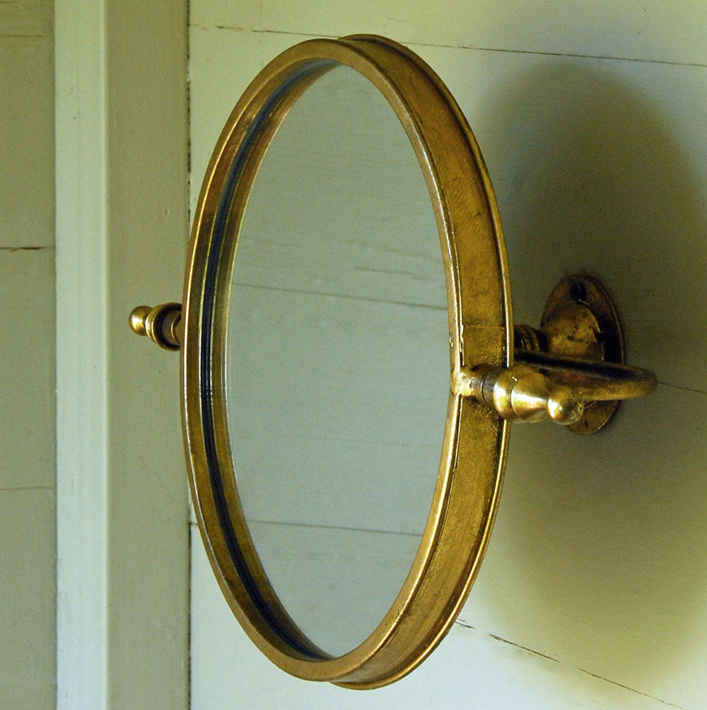 Small round gilt swivel mirror