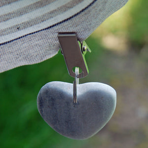 Set of four pale grey heart shaped stone table cloth weights