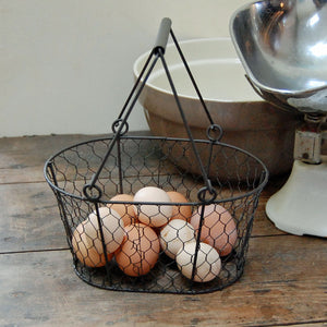 Traditional vintage style metal wire egg basket.