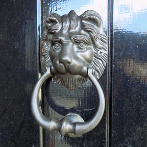 Classic black cast metal lion door knocker