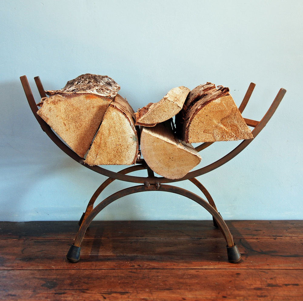 Traditional cast iron metal log store cradle