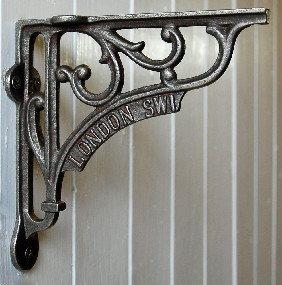 Cast metal antique London SW1 wall shelf bracket