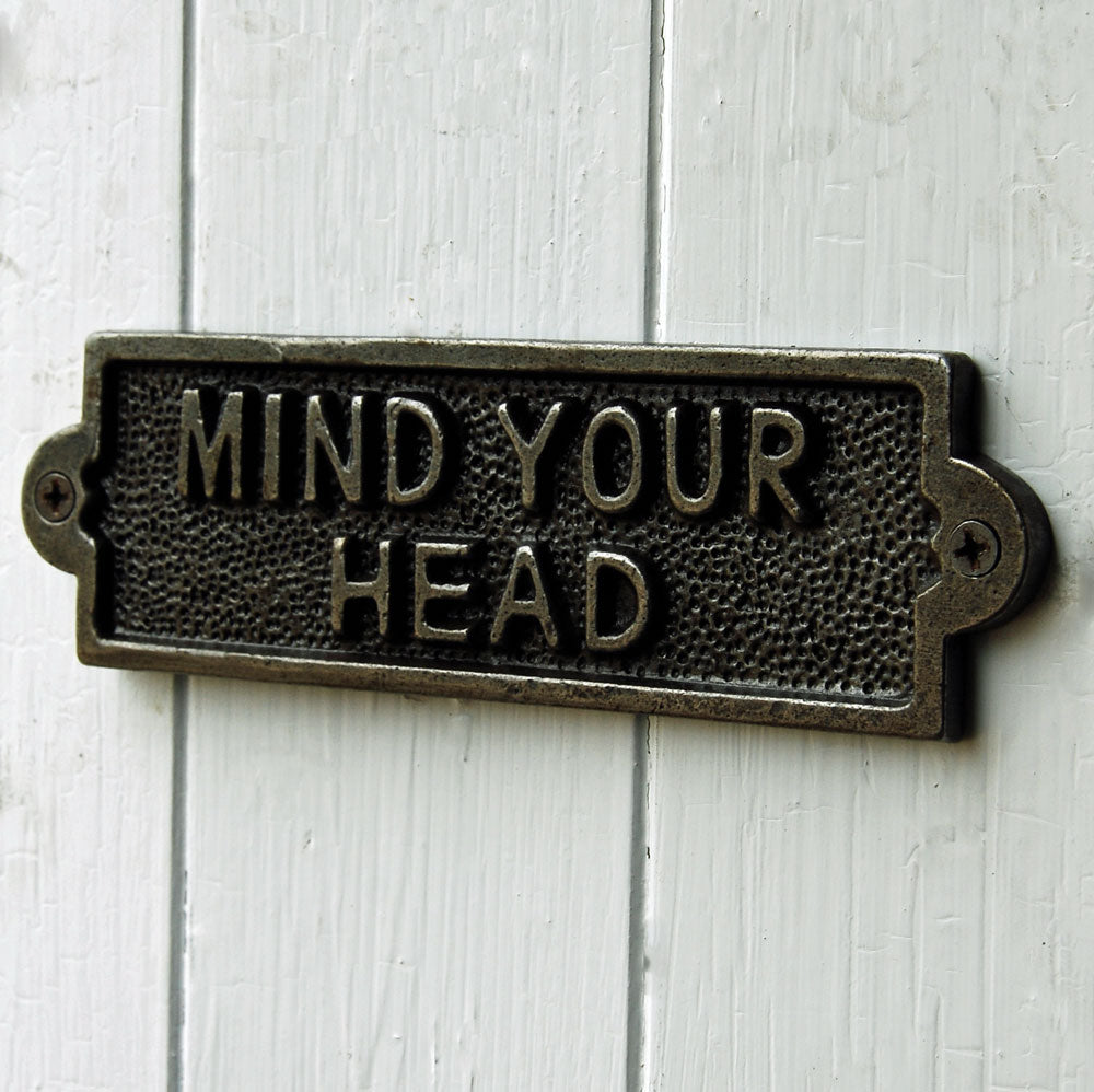 Cast metal mind your head plate sign