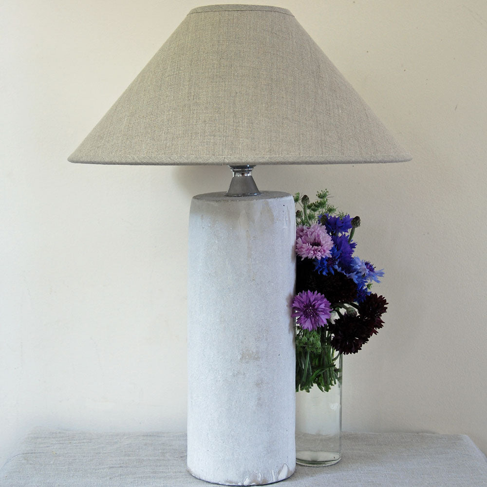 Contemporary concrete pillar table lamp with linen coolie lampshade