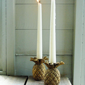 Pair of gold pineapple candle holders