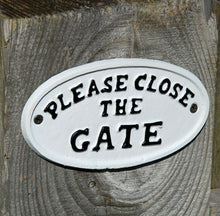 Traditional white cast metal please close the gate sign