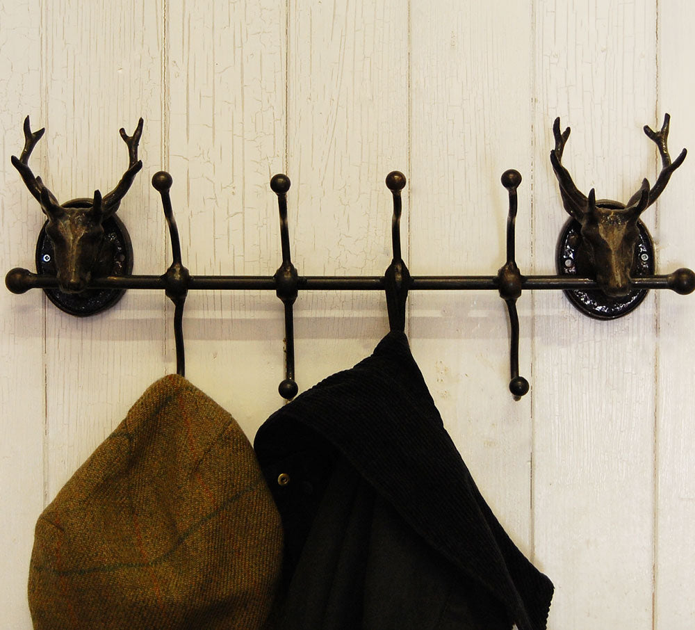 Cast iron antique style stag head row four coat hooks