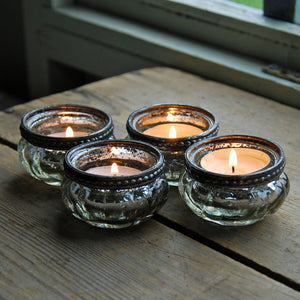 Set of four vintage silver glass pumpkin shaped tea light holder