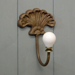 Cast metal shell wall coat hook with ceramic peg
